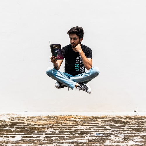 Man floats while reading adventure book